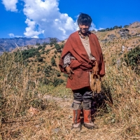 Tibetan Boy at 16000 feet attending Yak